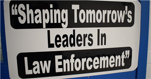 "Sign on Law Enforcement classroom that says ""Shaping Tomorrow's Leaders in Law Enforcement"""