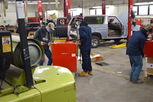 students wearing masks work in south tech's auto body shop