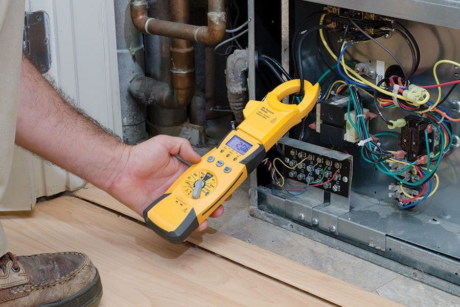 Person using voltage tester