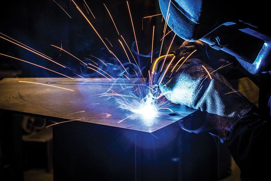Sparks from a welder working on a piece of metal
