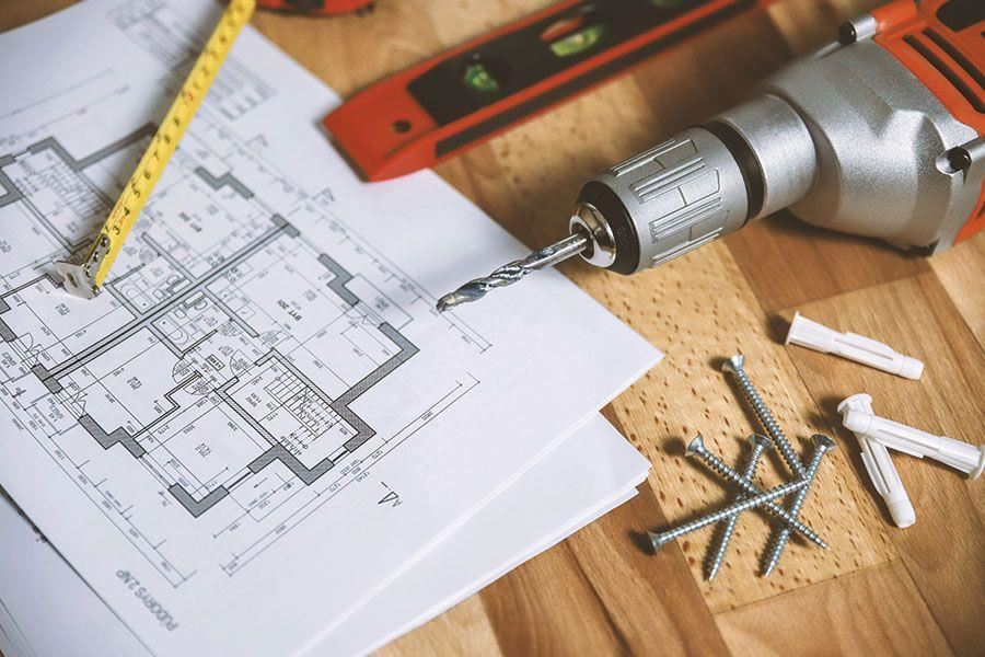 Blue print, measuring tape and other tools