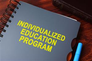 Notebook with Individualized Education Program on the cover