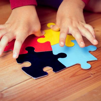 hands putting puzzle together