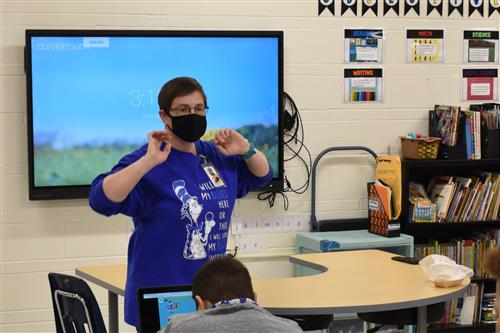 southview teacher speaking in front of class wearing mask